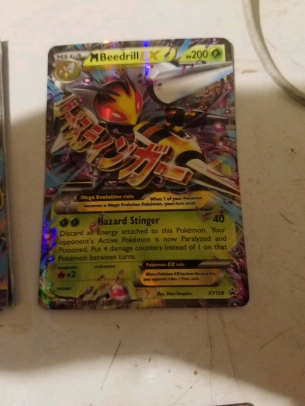 Mega EX Pokemon cards these are really expensive cards 18d32bae-3172-49b5-b402-af514412a0e3