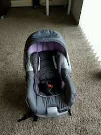 baby's gray and purple car seat carrier