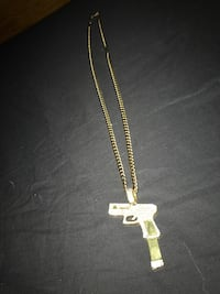 Gold plated chain and cubic zirconia glock pendant and two gold plated bottom grills  Guelph, N1H 6V8