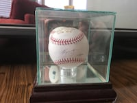 White and red baseball with baseball player signature decor
