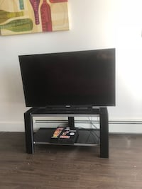 Black flat screen tv with black wooden tv stand Halifax, B3M 0G5