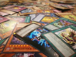 Lot of 50  yugioh cards plus a game mat  40% off