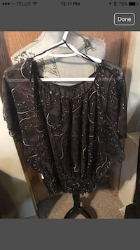Black paisley blouse with empire waist.