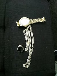 round gold analog watch with gold link bracelet Fullerton