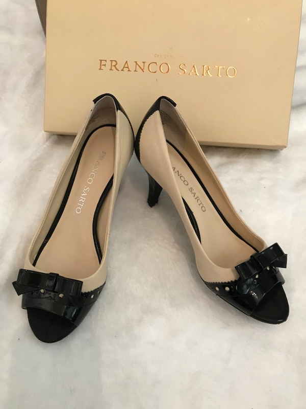 pair of women's beige-and-black Franco Sarto pumps with box