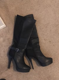 pair of black leather heeled boots Lansing, 48910