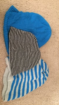 three assorted color knit caps
