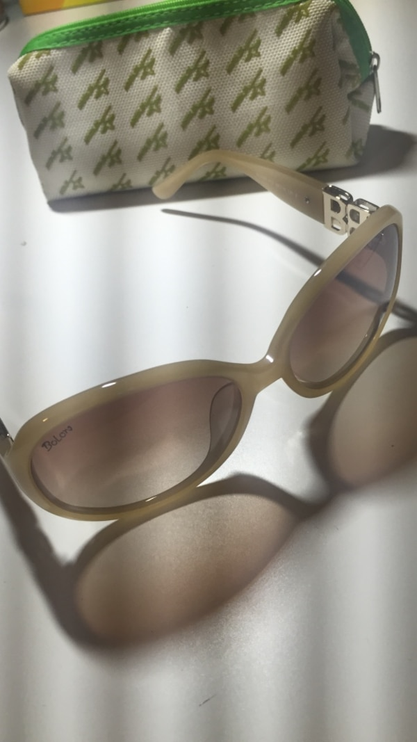 Beige framed sunglasses with case