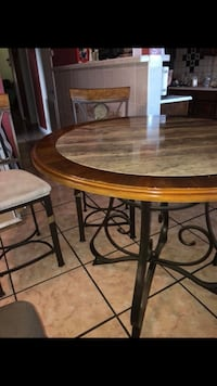 round brown wooden table with two chairs San Antonio, 78209