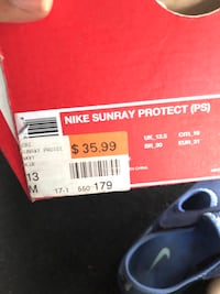 pair of black-and-blue Nike sandals Detroit, 48227