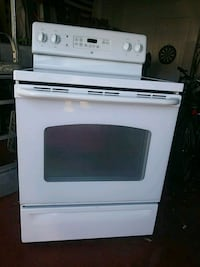 white and black induction range oven 785 mi
