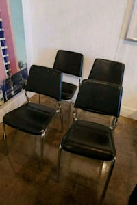 four black leather padded chairs Toronto, M3C 1N1