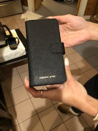 Michael kors  new cell phone holder just bought this weekend 80 dollars does not fit I phone android I think
