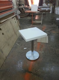 White wooden square table