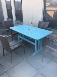 Rectangular blue table with four wicker chairs, outdoor patio set  Washington, 20009