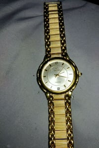 round gold-colored analog watch with link band Virginia Beach, 23452