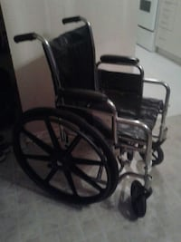 black and stainless steel folding wheel chair