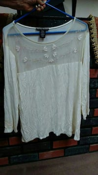 white floral boat-neck sweater