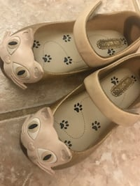 Girl's pair of white leather flats