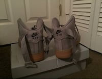 pair of gray Nike Huarache Washington