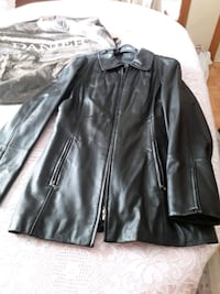 New - Danier leather coat. Great X-Mas gift
