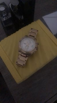 Round silver-colored chronograph watch with link bracelet