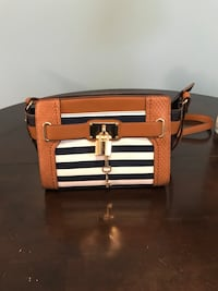white, black, brown leather crossbody bag