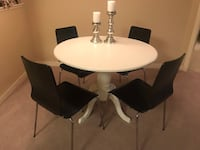 Four black IKEA dining chairs Abbotsford, V2S 8N9
