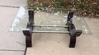 Wooden black living room table with glass top(paid $250 new) 13 mi