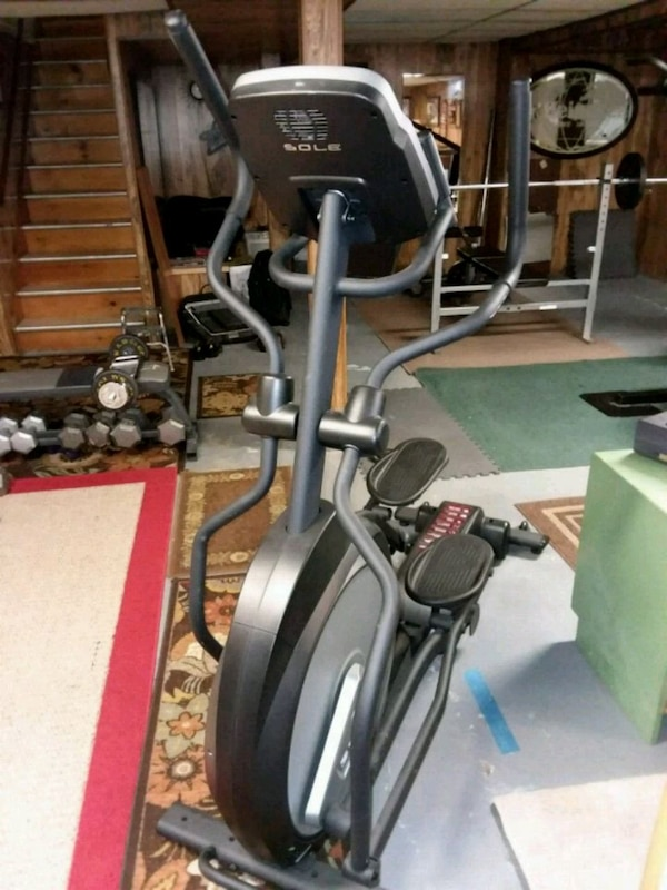 black and gray sole elliptical trainer