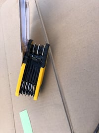 Black and yellow hand tool