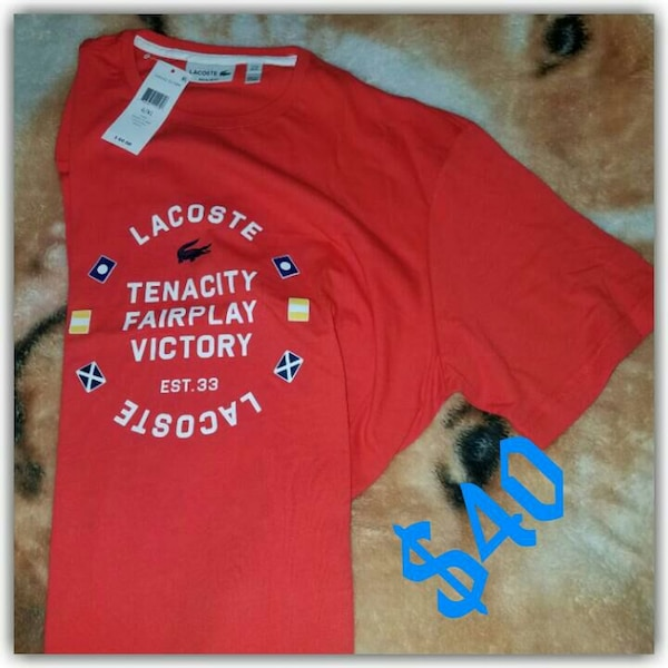 55c35f7e641a Used red lacoste tenacity fairplay victory printed crew neck t-shirt ...