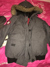 Super Tripple Goose jacket, perfect condition piece of zipper you use to pull broke off) Lachine, H8S 3N9