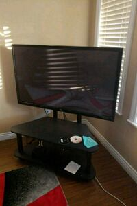black flat screen TV with remote New Westminster, V3M 5K6
