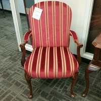 Red chair with stripes and wooden detail Oakville, L6L 5N1
