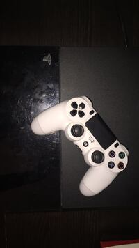 Black sony ps4 game console with controller Pickering, L1X 2B5