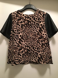 Leopard print top with faux leather sleeve