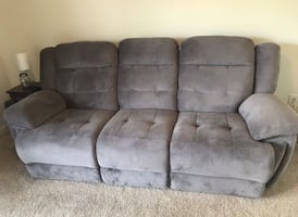 Grayish couch -- electric recliners on both sides