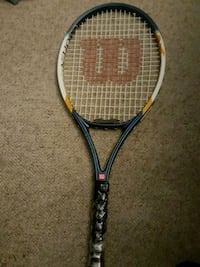 black and red Wilson tennis racket 53 km
