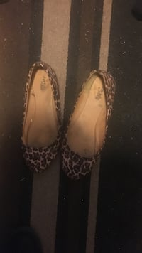 pair of brown-and-black leopard-print flat shoes
