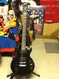Black epiphone electric guitar