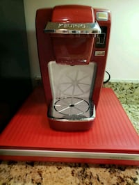 Red single cup Keurig coffeemaker Sterling