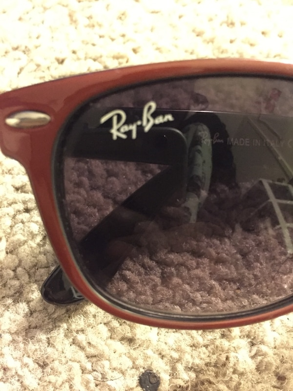 black and red framed Ray-Ban wayfarer sunglasses