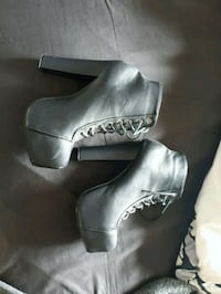pair of black leather platform chunky heeled booties