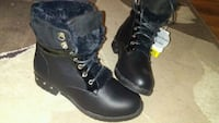 pair of black leather boots Winnipeg, R2P