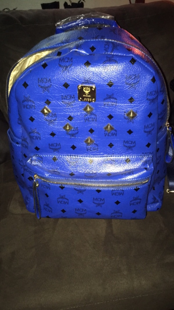 56cebe60149 Used blue MCM leather backpack and belt for sale in Syracuse - letgo