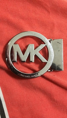 silver Michael Kors belt buckle