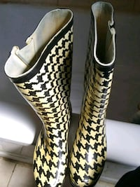 women's pair of white and black rubber boots   Baltimore, 21212