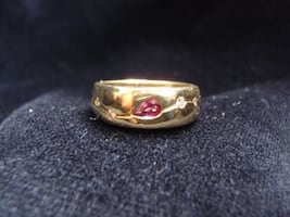 Might trade: Unique Ring.. Ruby center and diamond ring.