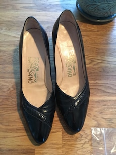 pair of black Salvatore Feragammo close-toe patent leather heeled shoes